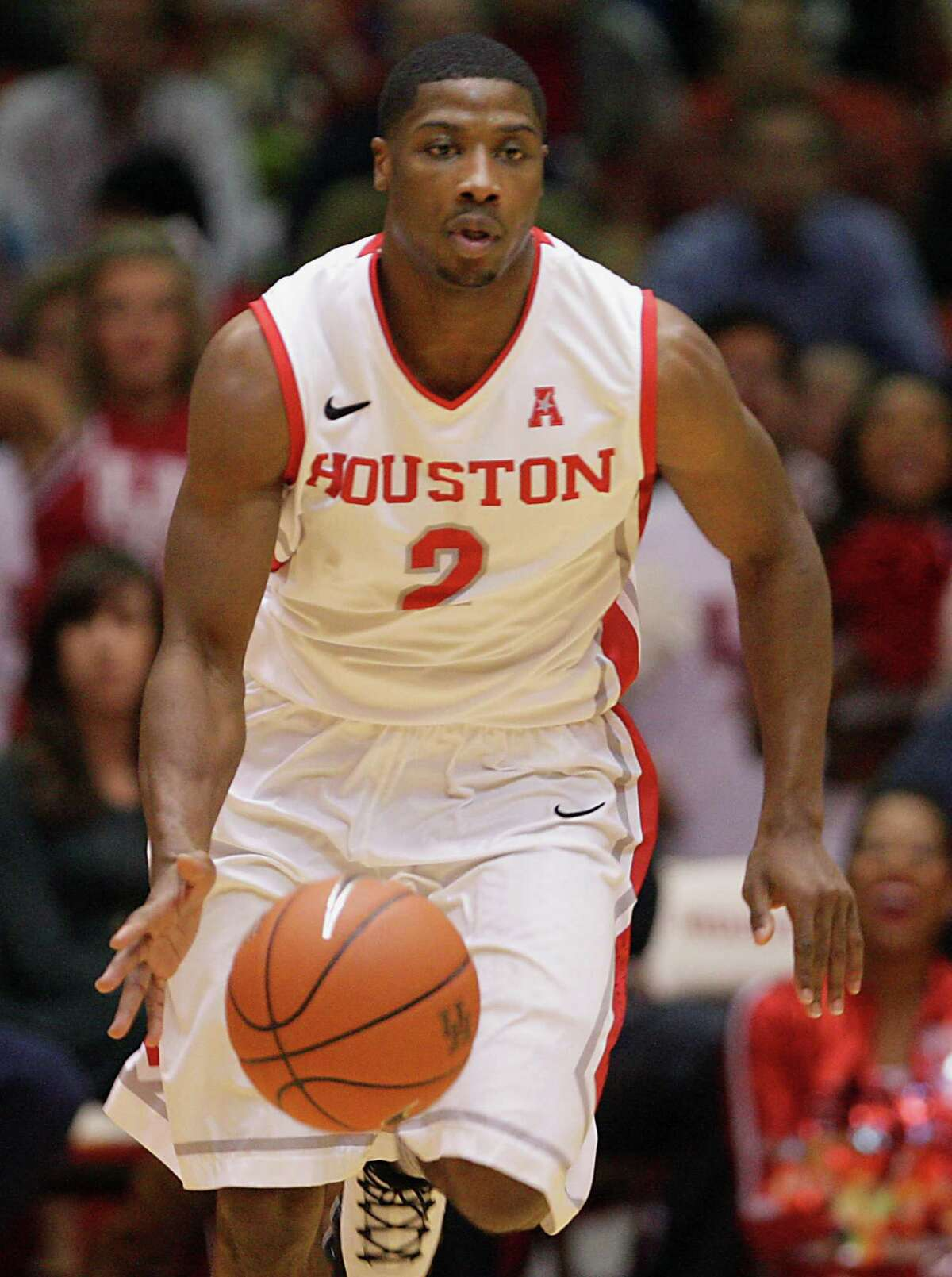 University of Houston guard Brandon Morris moves the down court against Louisville during the second half of men's college basketball game action at U of H's Hofheinz Pavilion Wednesday, Feb. 5, 2014, in Houston.