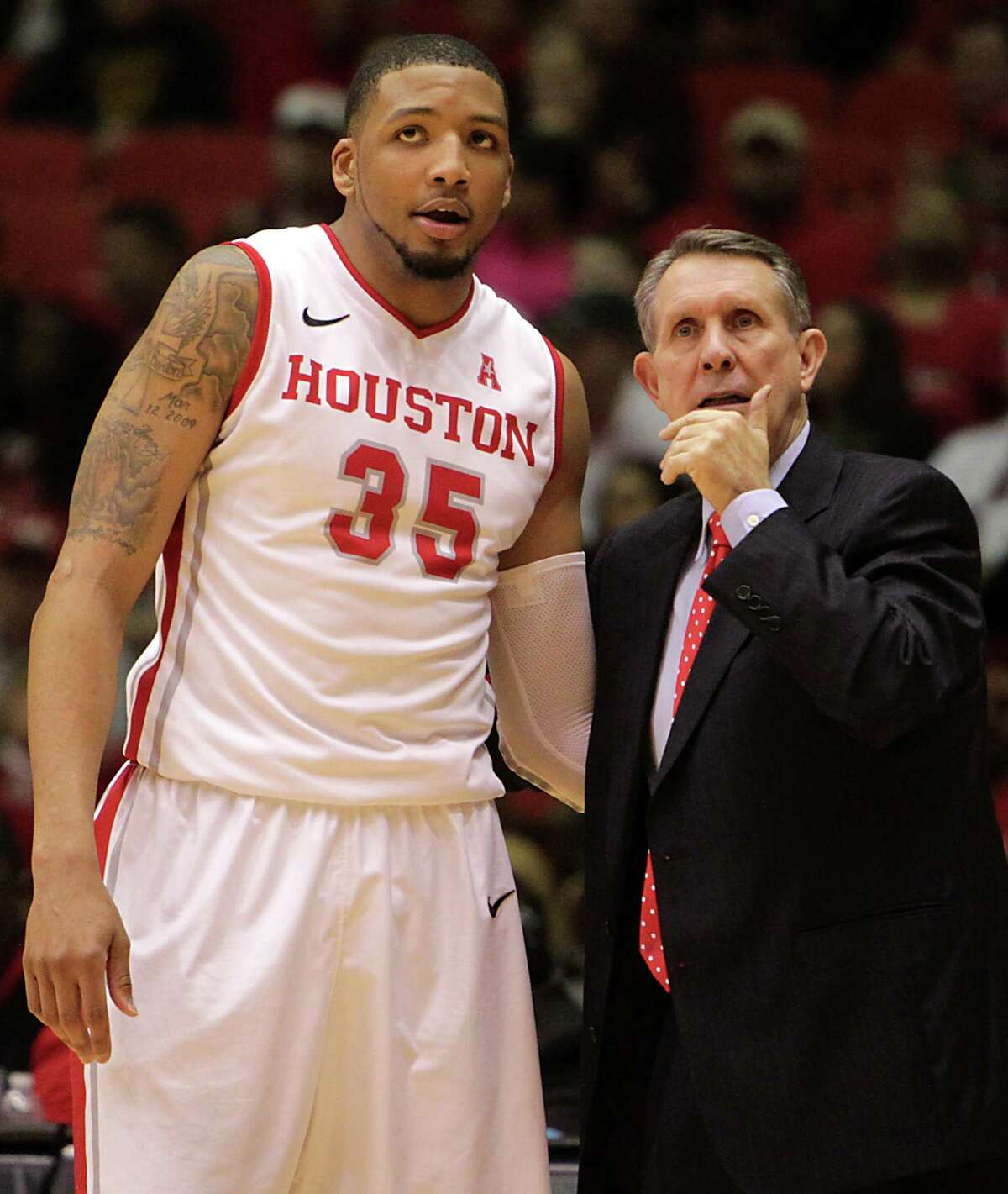 University of Houston forward TaShawn Thomas left, speaks with head coach James Dickey right, during the second half of men's college basketball game action at U of H's Hofheinz Pavilion Wednesday, Feb. 5, 2014, in Houston.