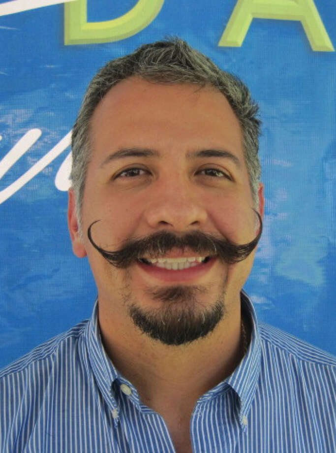 "Ricardo Ruiz, named Man of the Year by Wahl Clipper, beat out finalists from around the country with his ""clever handlebar mustache and goatee combination."" Photo: Courtesy Photo"