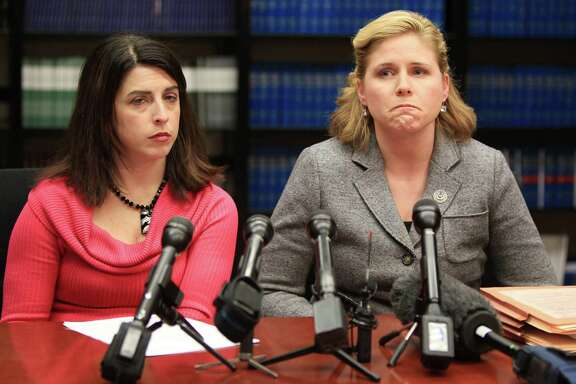 Prosecutors Alison Bainbridge and Janna Oswald announce the arrest at a news conference Wednesday.