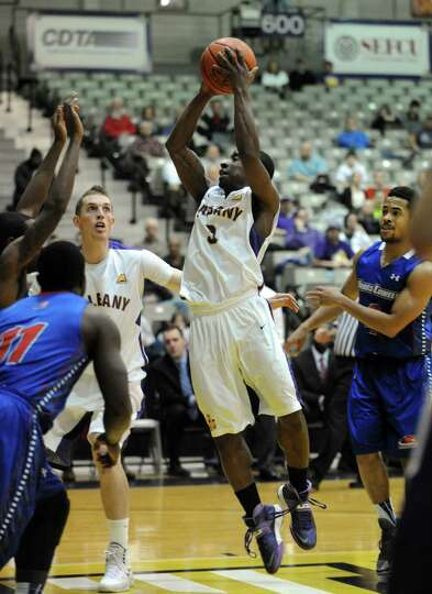 UAlbany's DJ Evans drives in for a basket during their men's college basketball game against UMass L