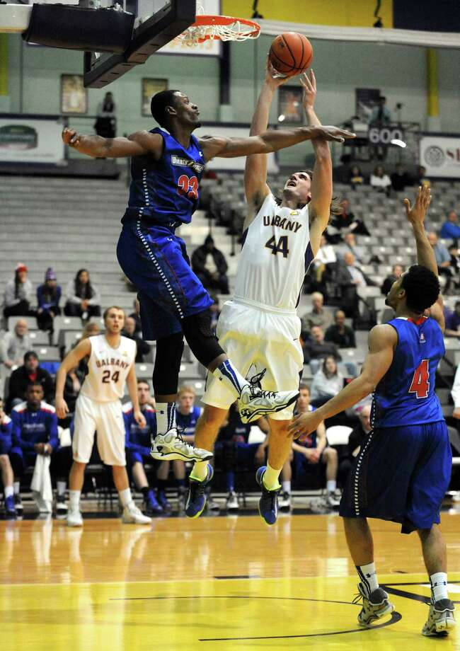 UAlbany's John Puk drives to the basket during their men's college basketball game against UMass Lowell at the SEFCU Arena on Wednesday Feb. 5, 2014 in Albany, N.Y. (Michael P. Farrell/Times Union)s Photo: Michael P. Farrell / 00025545A