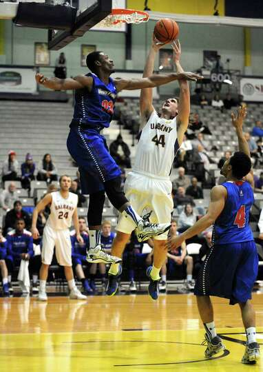 UAlbany's John Puk drives to the basket during their men's college basketball game against UMass Low