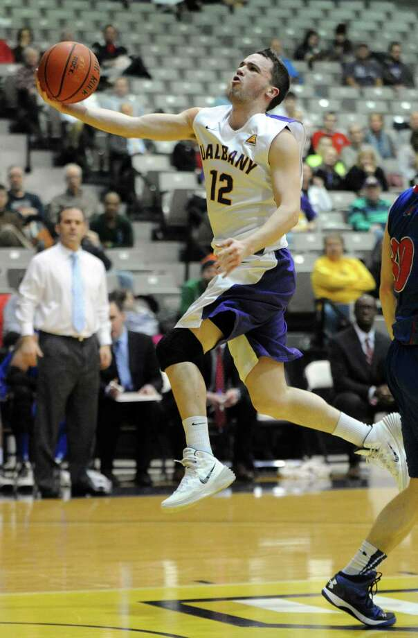 UAlbany's Peter Hooley drives to the basket during their men's college basketball game against UMass Lowell at the SEFCU Arena on Wednesday Feb. 5, 2014 in Albany, N.Y. (Michael P. Farrell/Times Union)s Photo: Michael P. Farrell / 00025545A