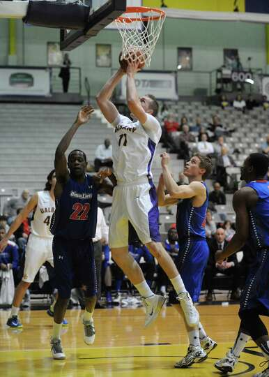 UAlbany's Luke Devlin goes in for a score during their men's college basketball game against UMass L