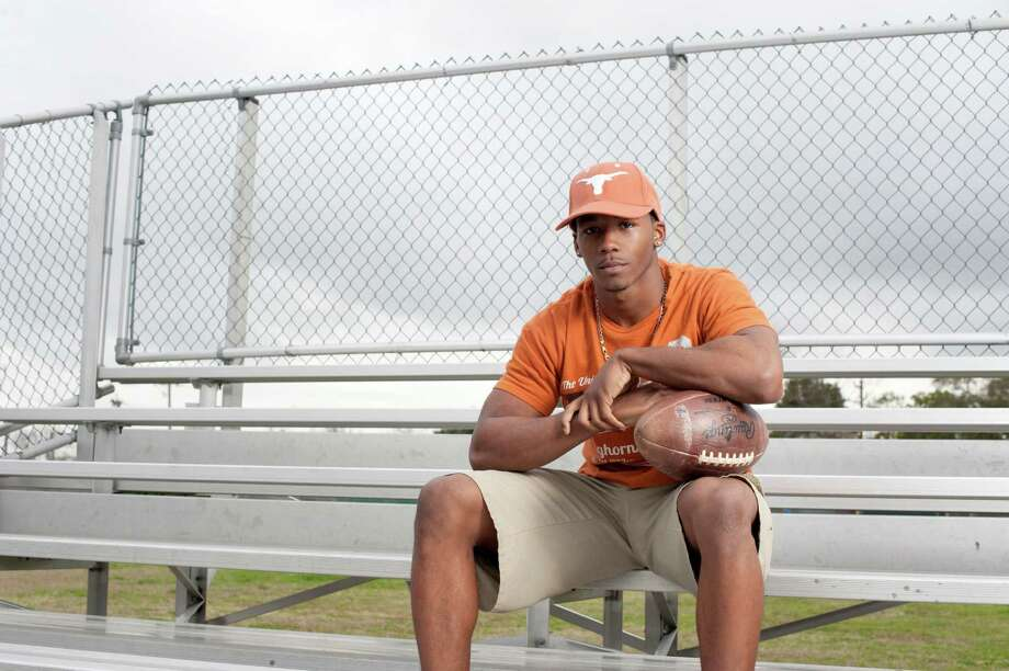 Receiver Roderick Bernard, here sitting near his old training grounds at Sharpstown High School, was part of Texas' 23-member recruiting class on Wednesday. Photo: Spike Johnson, Freelance / Houston Chronicle