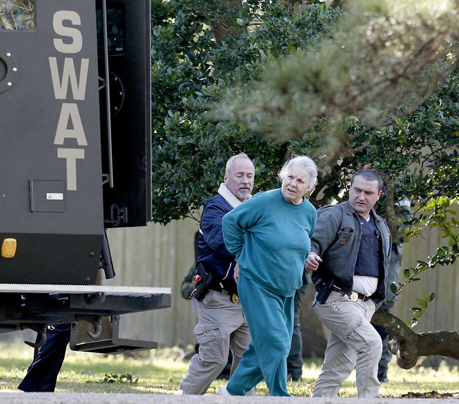 The following are photos from the standoff at the home of a La Marque couple on Wednesday. The man and woman have not been identified. The woman is accused of holding her husband hostage for hours before surrendering (Thomas B. Shea/For the Chronicle)