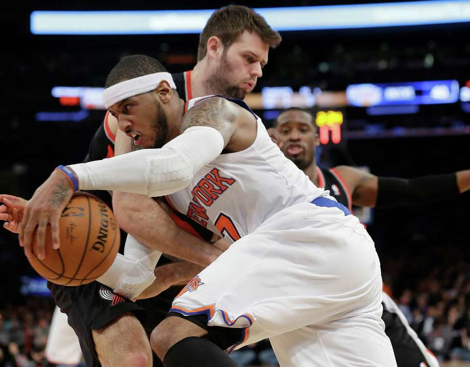 New York Knicks' Carmelo Anthony (7) drives past Portland Trail Blazers' Joel Freeland during the first half of an NBA basketball game, Wednesday, Feb. 5, 2014, in New York. (AP Photo/Frank Franklin II) ORG XMIT: MSG107 Photo: Frank Franklin II / AP