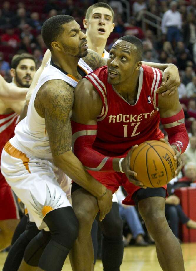 Feb. 5: Rockets 122, Suns 108  Suns forward Markieff Morris, left, grabs Rockets center Dwight Howard (12) as Howard looks to the basket. Photo: Brett Coomer, Houston Chronicle