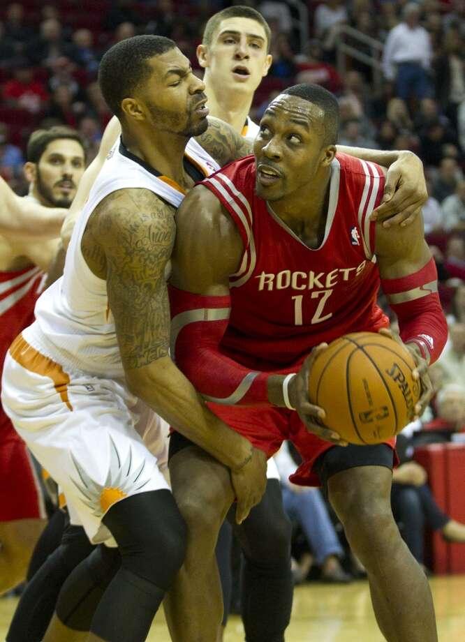 Feb. 5: Rockets 122, Suns 108Suns forward Markieff Morris, left, grabs Rockets center Dwight Howard (12) as Howard looks to the basket. Photo: Brett Coomer, Houston Chronicle