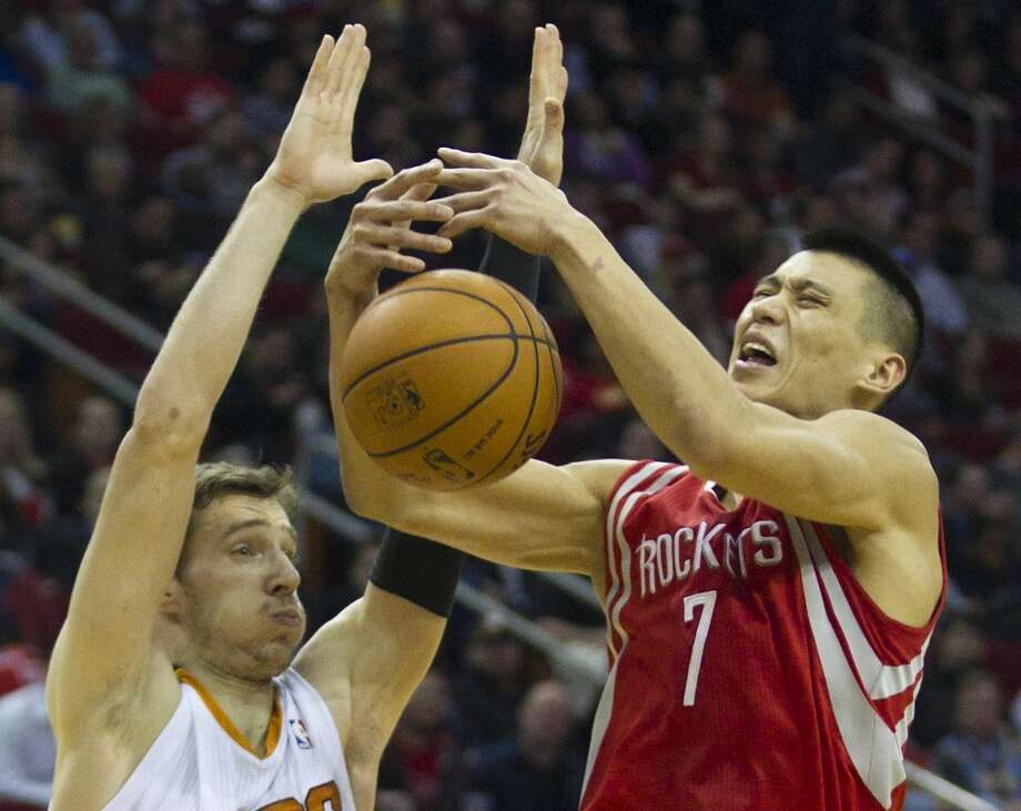 Rockets guard Jeremy Lin (7) loses the handle on the ball after making contact with Suns guard Goran Dragic. Photo: Brett Coomer, Houston Chronicle