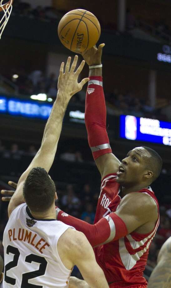 Rockets center Dwight Howard shoots over Suns center Miles Plumlee (22). Photo: Brett Coomer, Houston Chronicle