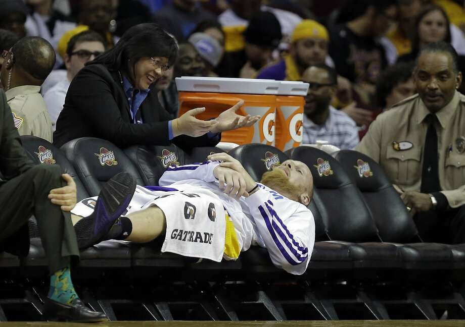 A depleted roster gives 7-footer Chris Kaman ample room to stretch out in Cleveland. The Lakers dressed just eight players, then lost two to injuries. Photo: Mark Duncan, Associated Press