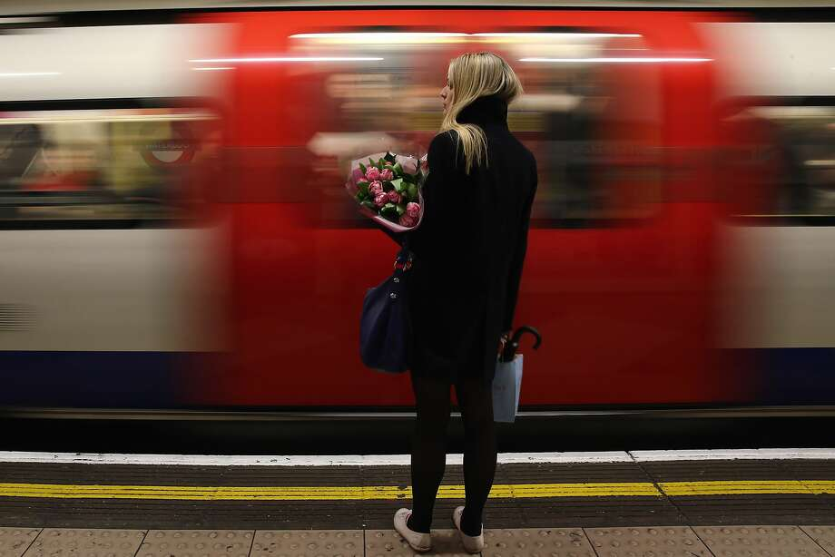 Tubes tied up: A woman waits for the next train at Waterloo Station in London during a 48-hour strike by underground workers 
