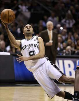San Antonio Spurs' Tony Parker tries to shoot for two as he is fouled during the first half against the Oklahoma City Thunder at the AT&T Center, Wednesday, Jan. 22, 2014. Photo: Jerry Lara, San Antonio Express-News