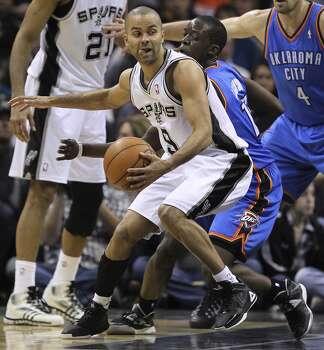 San Antonio Spurs' Tony Parker tries to get around Oklahoma City Thunder's Reggie Jackson during the second half at the AT&T Center, Wednesday, Jan. 22, 2014. The Thunder won 111-105. Photo: Jerry Lara, San Antonio Express-News