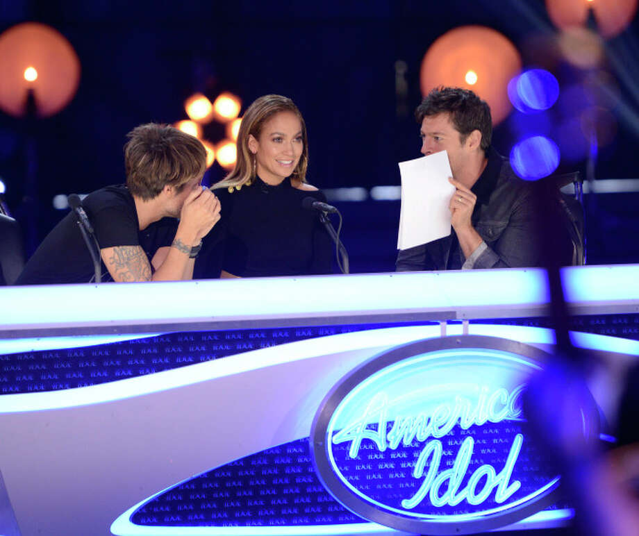 "AMERICAN IDOL XIII: L-R: Judges Keith Urban, Jennifer Lopez and Harry Connick, Jr. in the all-new ""Hollywood or Home"" episode of AMERICAN IDOL XIII airing Wednesday, Feb. 5 (8:00-10:00 PM ET/PT) on FOX. CR: Michael Becker / FOX. Copyright 2014 FOX BROADCASTING. / 1"