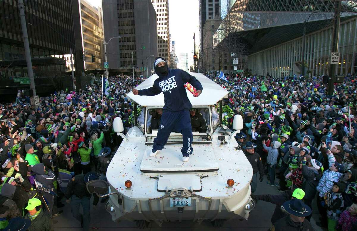 Marshawn Lynch throws Skittles back to the 12th Man during the Super Bowl Championship Parade on Wednesday, February 5, 2014 in downtown Seattle. An estimated 700,000 people came out to celebrate with Seattle's championship team.