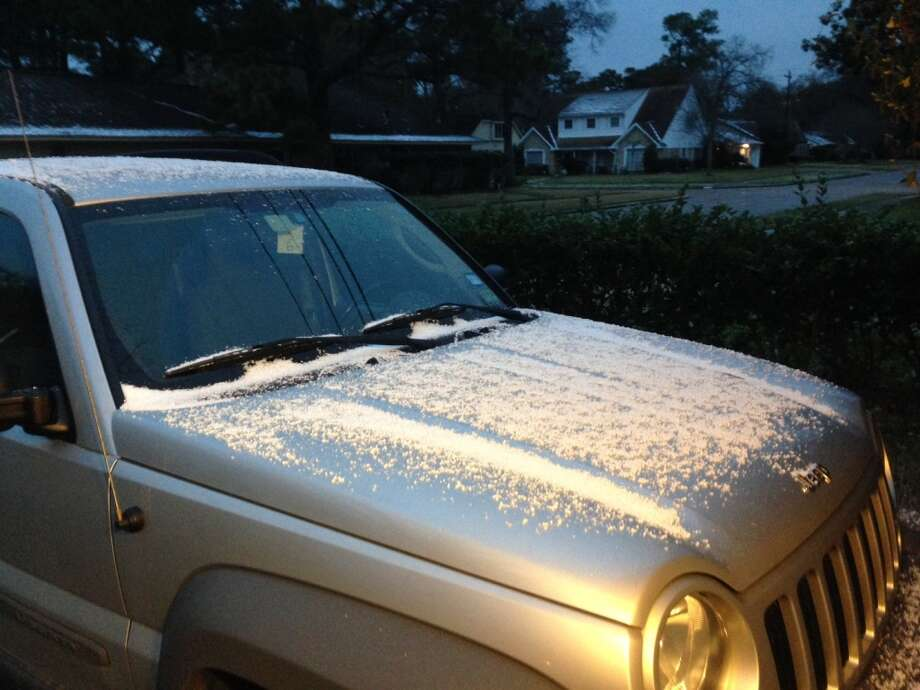 Ice collects on a car in Garden Oaks Thursday morning. (Photo by James Neilsen/Houston Chronicle)
