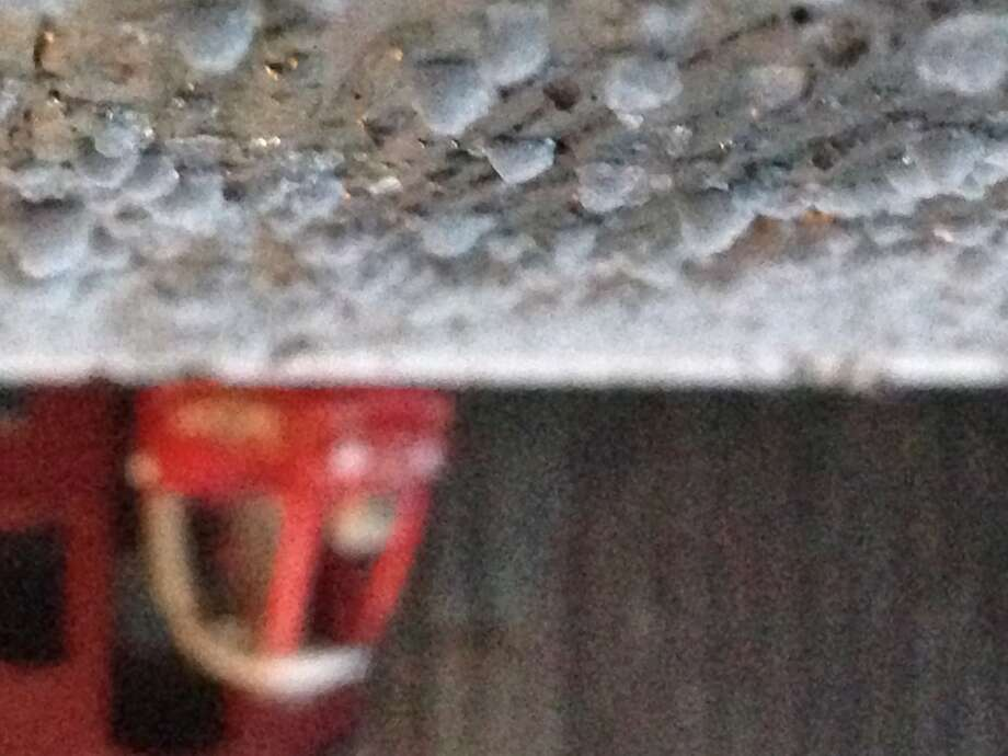 Ice collects in Northwest Houston Thursday morning. (Photo by Johnny Hanson/Houston Chronicle)