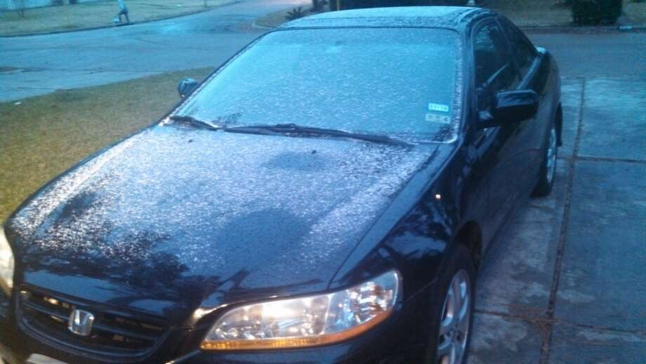 Ice collects on a car in Spring early Thursday morning. (Photo by Mark Gladstone/Houston Chronicle)