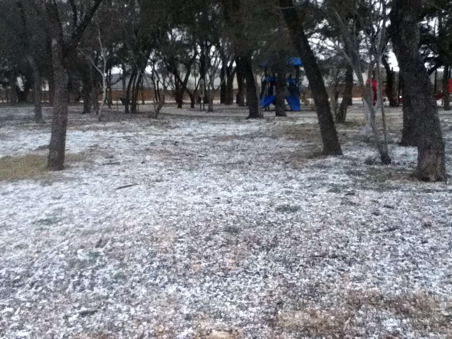 "A light dusting of what appears to be graupel, granular snow pellets also called ""soft hail,"" is seen at the Silver Oaks community park on the far west side. Photo: Michael Knoop/ San Antonio Express-News"