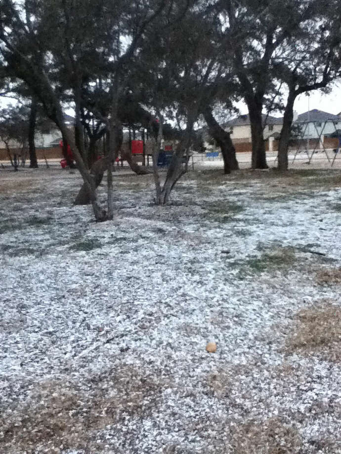 "A light dusting of what appears to be graupel, granular snow pellets also called ""soft hail,"" is seen at the Silver Oaks community park on the far west side."