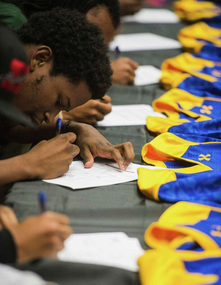Beaumont ISDOzen High SchoolGraduation: 6 p.m. June 7 at the Montagne Center(File photo) Derrick Mayfield and other athletes sign their letters of intent Wednesday morning. Clifton J. Ozen High School held a ceremony for national signing day Wednesday morning. Nine student athletes signed letters of intent with various universities. Photo taken Wednesday, 2/5/14 Jake Daniels/@JakeD_in_SETX Photo: Jake Daniels / ©2013 The Beaumont Enterprise/Jake Daniels