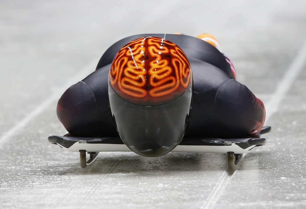 Canada's John Fairbairn is a heavy favorite for gold medal in the coolest skeleton helmet category at this year's Sochi Olympics. The neon brain helmet is brilliant and really shines with his near all-black suit. (Murad Sezer/Reuters)