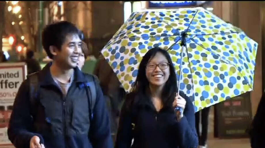 A couple walks through the rain in San Francisco.  Much needed rain returned to the Bay Area overnight. Photo: CBS San Francisco