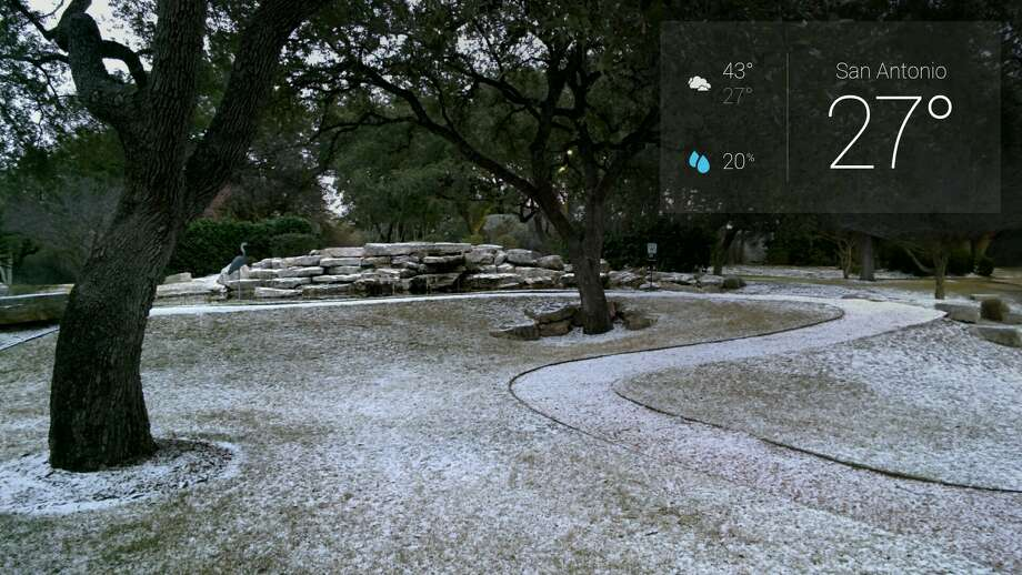 A reader uses Google Glass to take photos of graupel, which is snow encased in ice, on Thursday morning, Feb. 6, 2014. Photo: Benjamin Lee, Courtesy