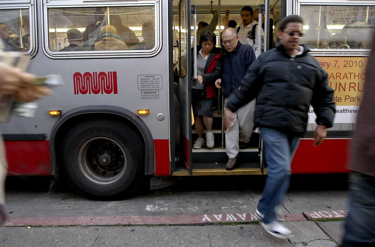 MUNI riders transfer at the bus stop off Geary Street.