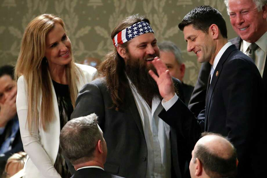 """Duck Dynasty's"" Willie Robertson, center, and his wife Korie, talk with Rep. Paul Ryan, R-Wis., before President Barack Obama's State of the Union address on Capitol Hill in Washington, Tuesday, Jan. 28, 2014. Photo: Charles Dharapak, AP / AP"