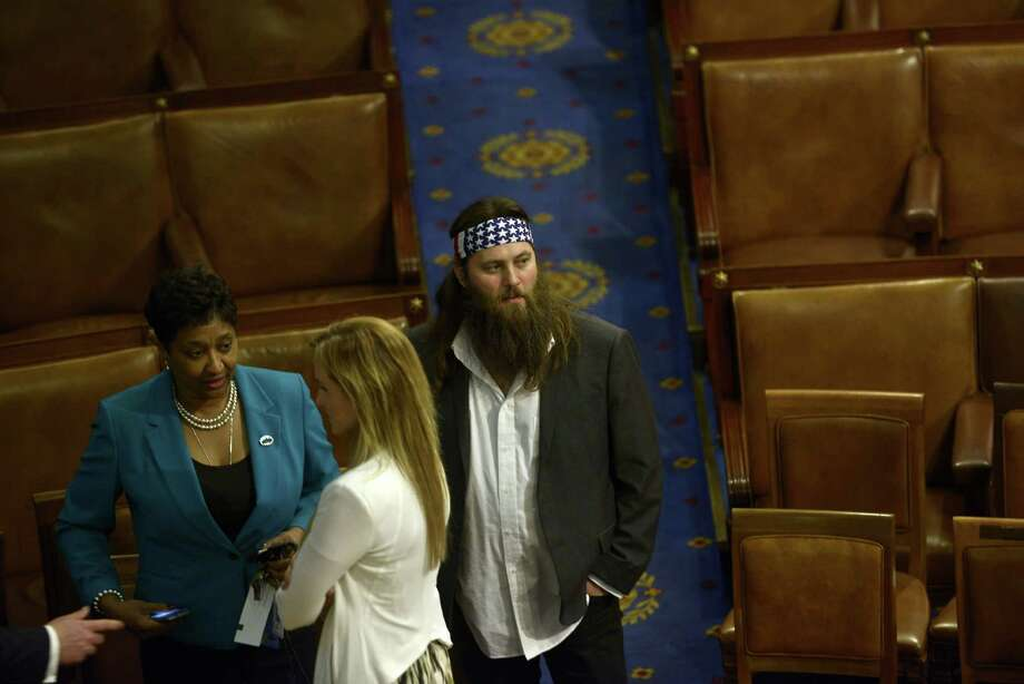 Duck Dynasty star Willie Robertson walks on the House floor after U.S. President Barack Obama delivered the State of the Union address before a joint session of Congress on Jan. 28, 2014 at the Capitol. Photo: BRENDAN SMIALOWSKI, AFP/Getty Images / 2012 Brendan Smialowski