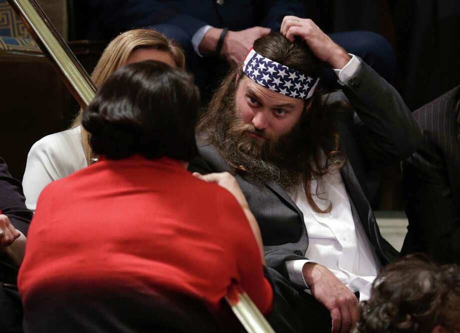 Willie Robertson, right, of the television show Duck Dynasty and his wife Korie Robertson wait for U.S. President Barack Obama to deliver the State of the Union address to a joint session of Congress in the House Chamber at the U.S. Capitol on Jan. 28, 2014.  Photo: Chip Somodevilla, Getty Images / 2014 Getty Images