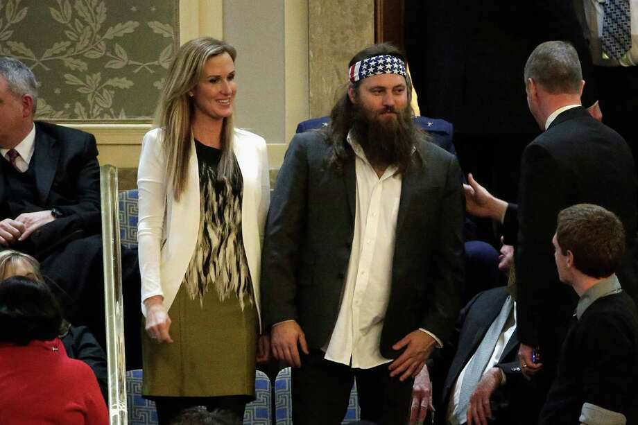 "Willie Robertson, right, of the television show ""Duck Dynasty"" and his wife 