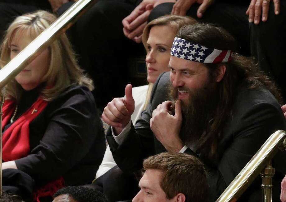 """Willie Robertson of the television show """"Duck Dynasty"""" and his wife  Korie Robertson were invited by Rep. Vance McAllister, R-La., as guests to President Barack Obama's State of the Union address on Jan. 28, 2014. See all the politicians who got to hobnob with the popular hunter and businessman. Photo: Alex Wong, Getty Images / 2014 Getty Images"""