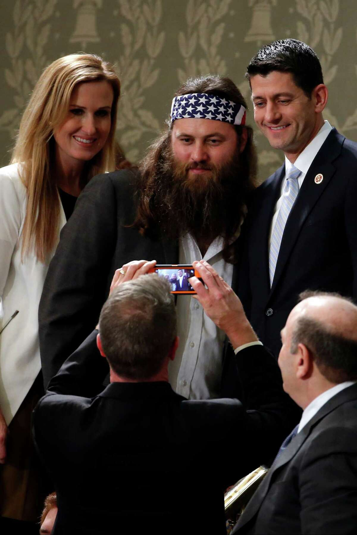 """""""Duck Dynasty's"""" Willie Robertson, center, and his wife Korie, pose with Rep. Paul Ryan, R-Wis., before President Barack Obama's State of the Union address on Capitol Hill in Washington, Tuesday, Jan. 28, 2014."""