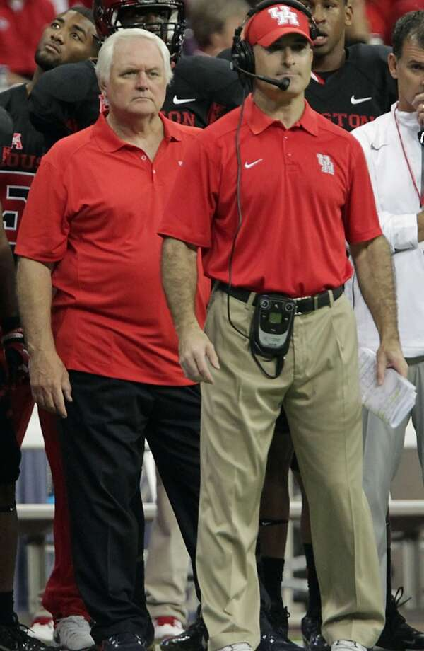 Wade Phillips stands behind UH head coach Tony Levine during the Cougars matchup with South Florida on Oct. 31, 2013 at Reliant Stadium. Photo: James Nielsen, Houston Chronicle