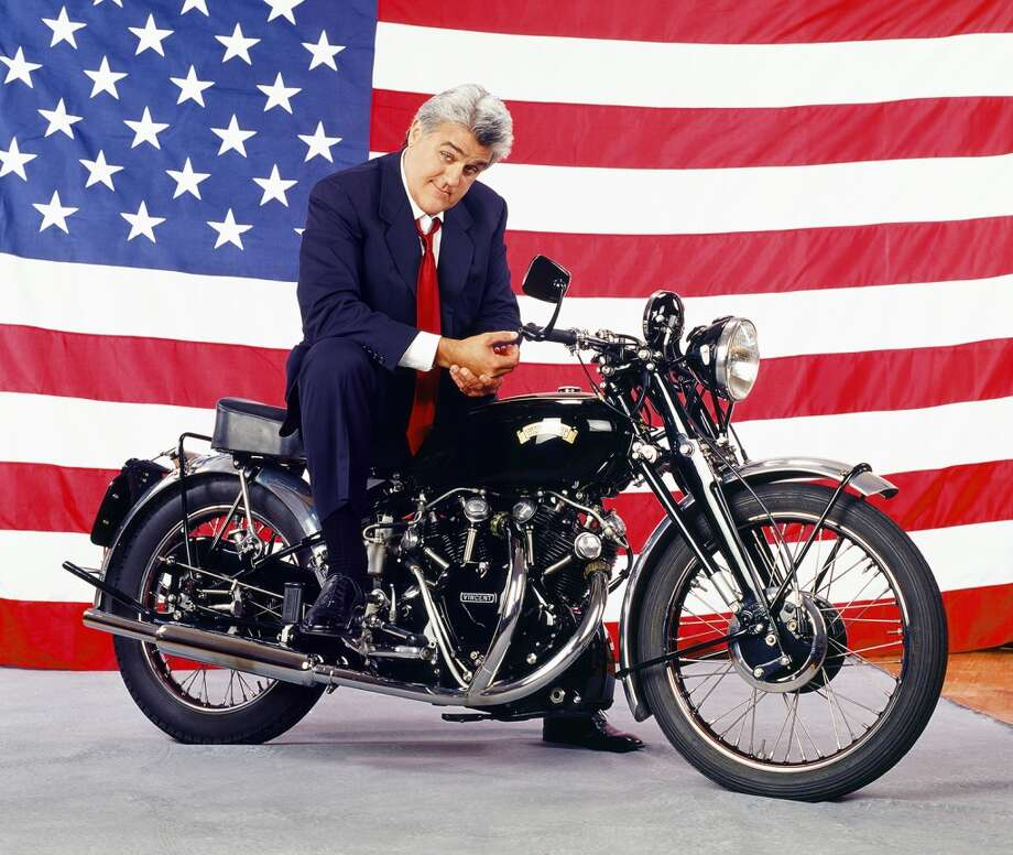 Jay Leno poses with his 1939 Vincent motorcycle. Photo: NBC, NBC/NBCU Photo Bank