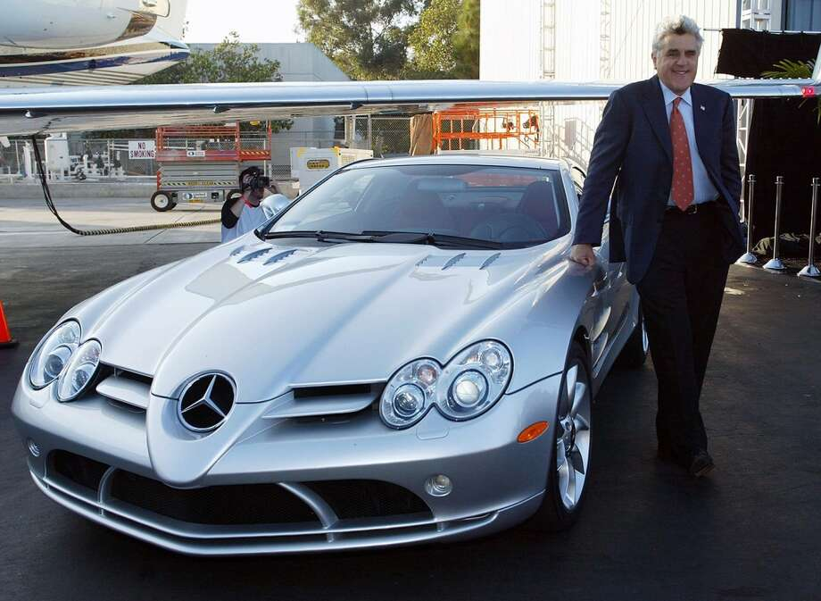 "Jay Leno stands by his Mercedes SLR during the Robb Report's ""Best of the Best"" at Hangar Eight in 2004. Photo: Frederick M. Brown, Getty Images"