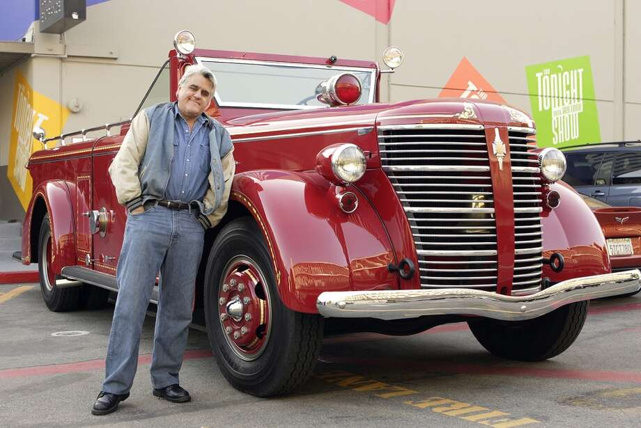 Host Jay Leno drives away in one of his many automobiles, a vintage collector red fire engine, after a show in 2007. Photo: Paul Drinkwater, Paul Drinkwater/NBCU Photo Bank