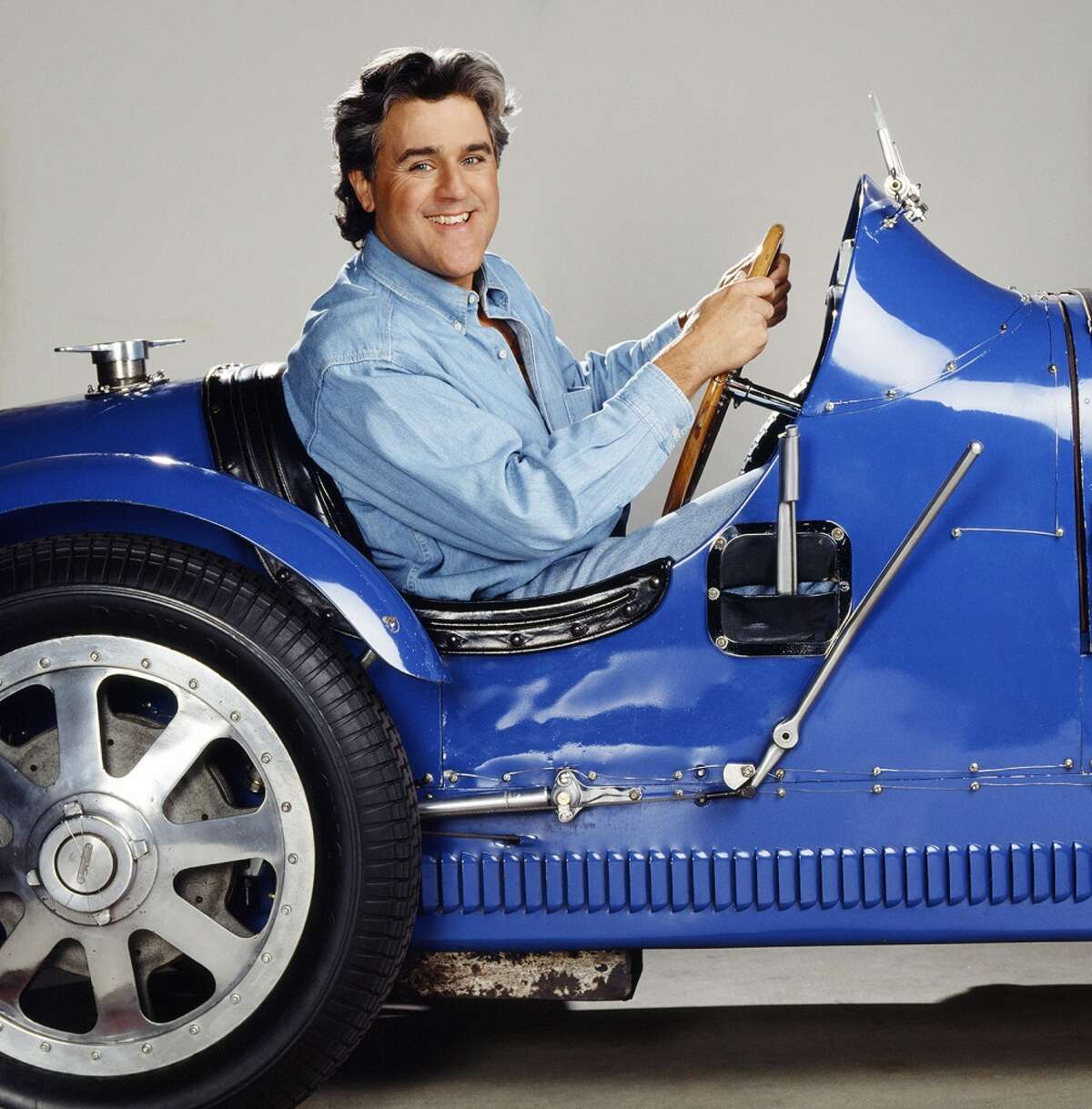 Jay Leno behind the wheel of his Bugatti Type 51.
