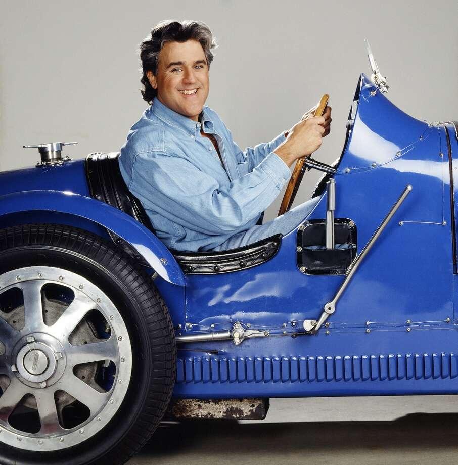 Jay Leno behind the wheel of his Bugatti Type 51. Photo: NBC, NBC/NBCU Photo Bank