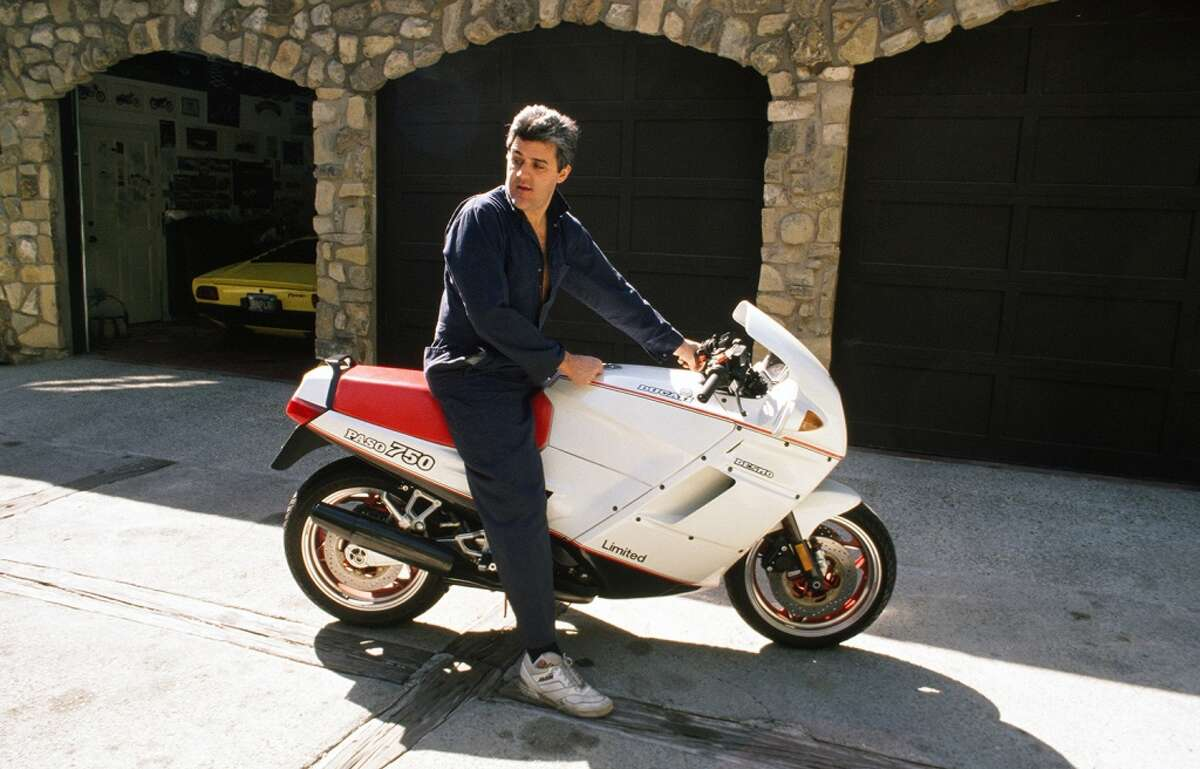 Jay Leno poses with a late-80s Ducati Paso 750