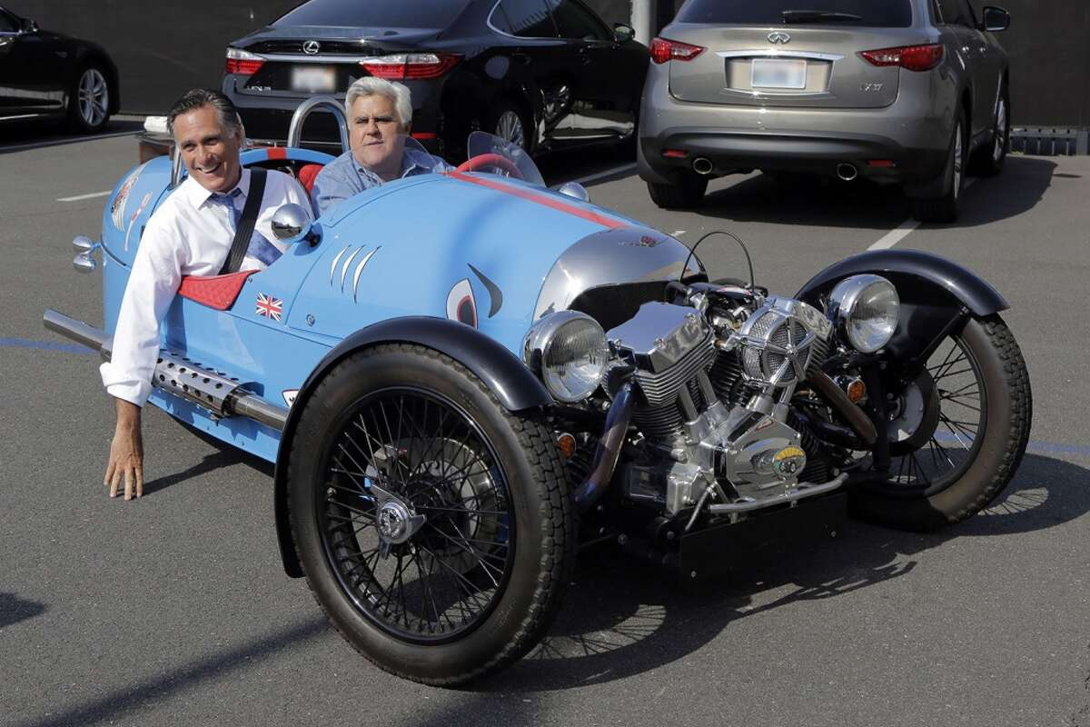 Jay Leno takes former governor Mitt Romney for a ride in a new Morgan trike.