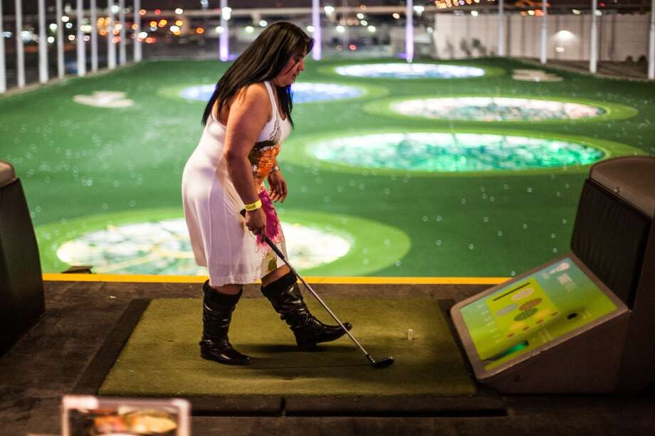 Antoinette Chorba, a platinum member at Top Golf, prepares to get another golf ball during the Suits and Boots party Saturday January 25th in Houston. Suits and Boots is a charity event supporting Heroes Project where party goers wore bathing suits and/or boots. (Michael Starghill, Jr.) Photo: Michael Starghill Jr.
