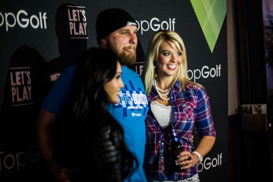 Julia Hoang, Billy Chabot and Shay Creech pose for a photo at Top Golf during the Suits and Boots party Saturday January 25th in Houston. Suits and Boots is a charity event supporting Heroes Project where party goers wore bathing suits and/or boots. (Michael Starghill, Jr.) Photo: Michael Starghill Jr.