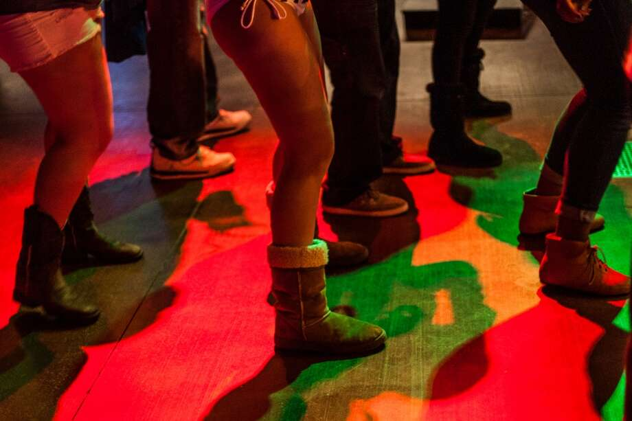 Boots on the dancefloor at Top Golf during the Suits and Boots party Saturday January 25th in Houston. Suits and Boots is a charity event supporting Heroes Project where party goers wore bathing suits and/or boots. (Michael Starghill, Jr.) Photo: Michael Starghill Jr.