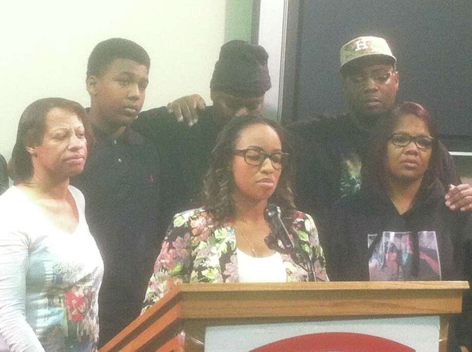 Michelle Carson spoke at a Crime Stoppers news conference Thursday morning about the shooting death of her brother Jawon Carson, whose body was found Dec. 13 under a bridge in north Houston. Other family members also were the news conference Photo: Dale Lezon